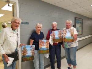 Residents showing off their artwork
