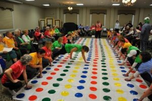 Residents play a giant game of Twister